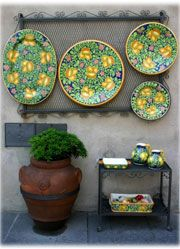 Hand painted Italian stoneware...gorgeous love the colors! Pottery would cover those unsightly patches on the patio