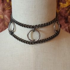Black chain & chrome O rings collar  All handmade, original design. Strong & Beautifully made. Any sub, would love the looks and feel of this collar. Clasps in back with two swivel snap hooks.  Two sizes available, 12 1/2 to 14 1/2 neck and 15 to 17 neck. All items are hand made and may vary some.   The products in my shop are for use by consenting adults as novelties, fashion accessories, and adult toys. Items are not meant for suspension purposes. Not all pieces are welded. Items may…
