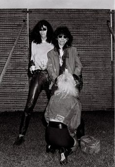 "Joey Ramone (the ramones) and Stiv Bators (the dead boys) and a mysterious lady ""work on Stiv!!"" - photo by ©Richard Bellia."
