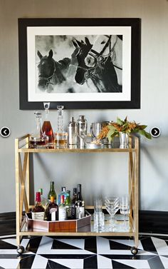 The Gerard Bar Cart showcases a gold leaf finished frame with X detailing on either side, with a mirrored top and lower shelf. A rolling bar cart like the modern, contemporary Gerard Bar Cart delivers a conversation piece as you entertain guests Bar Cart Decor, Bar Cart Styling, Jeff Lewis Design, Gold Bar Cart, Vintage Bar, Bar Furniture, Bars For Home, Decoration, Interior Inspiration