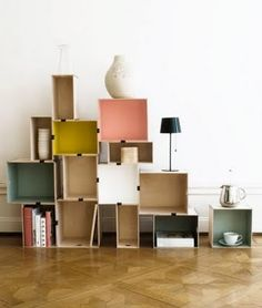 wooden crates storage: like that the boxes are stacked in an asymmetrical order and painted in various colors