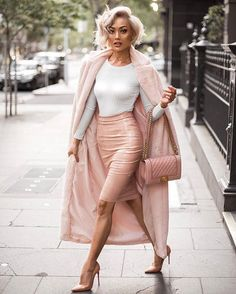 This pink lady's got some seriousss swag  @micahgianneli styles The 'Drag Me Down' Bodysuit in White teamed with The 'Smooth Talker' High Waisted Vinyl Skirt in Nude.  More colours of both pieces stocked online! Shop Micah's full look now by tapping the link in our bio! UK Next Day Delivery available up until the 22nd for arrival before Christmas! Worldwide Delivery also available!