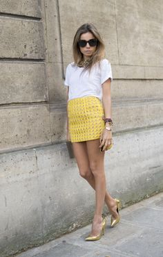 Statement skirts and trousers are a relatively new phenomemnon in fashion speak. It used to be that you picked a jazzy blouse or top and teamed that with something less flashy. Nowadays it's all about your bottom half. We're loving Fashion Editor Erica Pelosini's short sharp mini in canary yellow to combat soaring temperatures. A simple tee is an effortlessly chic combination whilst a gold stiletto amps up the daytime vibe. Photo: Kirstin Sinclair