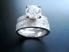 Palladium Crinkle Ring Set with customer's center stone set in Platinum prong setting on engagement ring, shown with wide wedding . Wide Wedding Bands, Wedding Rings, Crinkles, Modern Jewelry, Wedding Jewelry, Engagement Rings, Stone, Diamond, Metal
