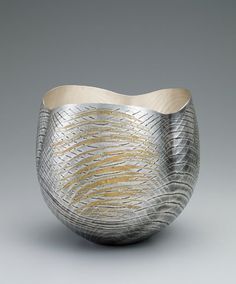 "Osumi Yukie. Silver Vase, ""Sound of Wind"". Japan, 2014. Hammered silver with nunomezogan (textile imprint inlay) decoration in lead and gold. 10 7/8 x 12 inches (30.2 x 27.5 cm). Asia Week New York 