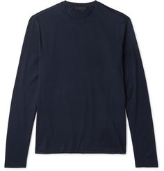 The ideal piece to see you through those tricky trans-seasonal days, Prada's long-sleeved T-shirt is made from lightweight stretch-cotton jersey in a deep navy hue. The semi-fitted cut and crew neckline ensure it layers effortlessly - try yours under a sweater or solo with slim jeans.