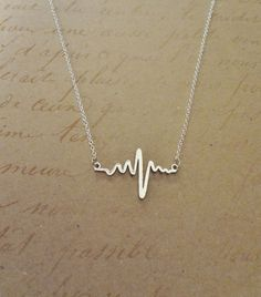 Beautiful Heart Beat Electrocardiogram EKG Rhythm Necklace. This is a wonderful gift for anyone in the medical field or could be a sentimental gift to anyone that you love or a memorial necklace. This