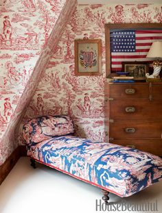 In John Knott and John Fondas's Maine master bedroom, the spirited theme sprang from Fondas's collection of Washington memorabilia and American flags. A toile pattern that depicts American icons covers both the daybed and the walls.   - HouseBeautiful.com
