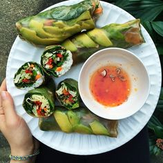 fitwithoutfat:Lunch part 2: spring rolls loaded with cabbage, carrots, cucumber, spinach, jalepeño, red bell pepper, cilantro, avocado and sometimes rice. Served with a sweet chili dipping sauce (no I did not make it). I love this lifestyle  (at Heaven)