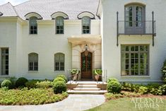 The exterior features a custom limestone façade; the metalwork is by Charles Calhoun. Atlanta Homes, Interior And Exterior, House, House Exterior, New Interior Design, Exterior Brick, Stucco Homes, House Tours, House And Home Magazine