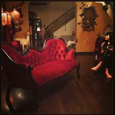 inside Kat Von D's house, love the victorian couch and pinned butterflies in the background