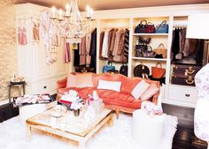 Rosie Huntington-Whiteley's feminine closet with furry rug, French sofa, built-in shelving, and crystal chandelier.