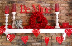 We love this #Valentine's Day mantel decor, and the great heart-shaped cutout garland.