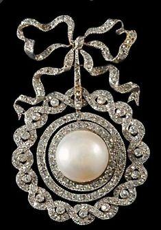 Edwardian diamond and pearl brooch.
