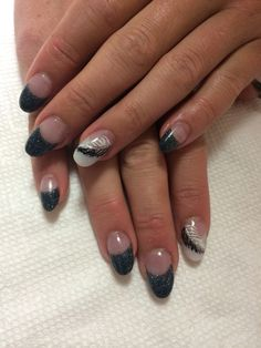 Hand painted feathers on almond shape acrylic nails