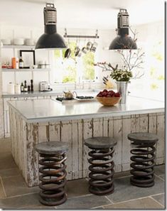 industrial kitchen  Oh!  How great are those stools?!