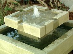 Water Features for Any Budget from DIYnetwork.com: Geometric shapes provide a striking design feature for the landscape.