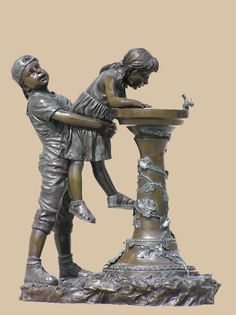 Get this beautiful Bronze sculpture depicting a boy lifting little girl for water Look at the flying hair of the girl, outstanding art shown by the artist