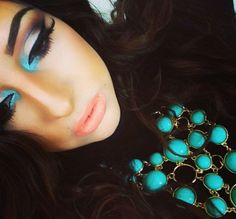 Love the pop of blue in her makeup & that necklace is sick