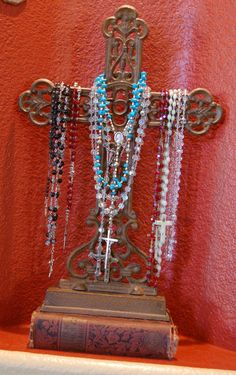 on cross with vintage books.idea for mom's rosaries Holy Rosary, Rosary Catholic, Catholic Art, Religious Icons, Religious Jewelry, Religious Art, Rosary Beads, Prayer Beads, Prayer Corner