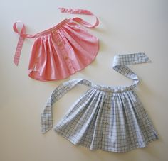 Swingy Spring Skirts Made From Old Cotton Shirts  Curved shirt tail hems are having a fashion moment this spring, so I thought it would be fun to upcycle some actual shirts into skirts for little girls.  Get complete pattern information at http://blog.littlegoodall.com/?p=150