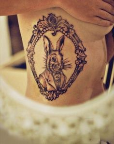 Inspirational images of tattoos, with everything from skulls and dragons to meaningful quotes. Tattoos help to tell the world who we are. Browse, enjoy and share the tattoos of others, or upload your own. Bunny Tattoos, Rabbit Tattoos, Ink Tattoos, Tatoos, Animal Tattoos, White Rabbit Tattoo, Alice And Wonderland Tattoos, Framed Tattoo, Tattoo Frame