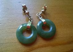 A stunning pair of vintage jade earrings in 9ct gold. They hang beautifully. A nice size, not too small or large. Perfect. Wonderful quality. They are a little over 1 inch in total length and the jade hoops are 1 and a half cm wide. The gold has a rosy hue to the patina.