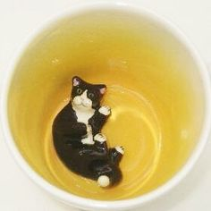 Hey, I found this really awesome Etsy listing at https://www.etsy.com/listing/86471064/black-lying-cat-surprise-mug