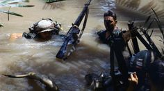Soldiers of the US Army 9th Infantry Division make their way through water in the Mekong Delta.
