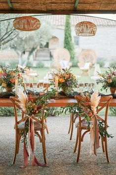 Rustic wedding table setting and floral arrangements in refurbished barn at Domaine de Bres Provence, France... Wedding Planner: Mélanie Orsini | Brides Dress: Aurélie Mey | Hair & Make Up: Maison Marcelle | Videographer: Just Go Wedding | Lead Photographer: Solophotographie | Cake: Traiteur Lavallergue | Venue: Domaine de Brés | Florist & Decorations: Anyflowers | Stationery: Et Caetera Studio | Beer Truck: Beer Truck Provence | Accessories: Appoline Bijou Végétal | Decorations: Maison… Magical Wedding, Tent Wedding, Wedding Table, Rustic Wedding, Floral Chair, French Wedding Style, Hair And Makeup Artist, Wedding Styles, Wedding Planner