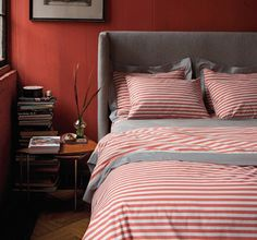 striped bedding and headboard