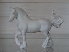 2017. Customized Breyer Traditional size friesian to gypsy vanner stallion. Sold unpainted. Custom by Zane Lahdenranta (Frosty Birch Studio).