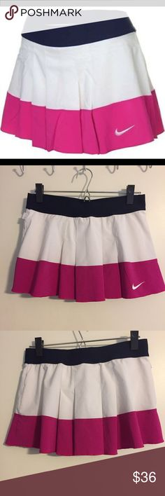 Nike DryFit pleated Skirt Navy/Pink/White Sz Med Nike Womens DriFit/Stay Cool Pleated Skirt/Skort Pink/White/Navy.  Size Medium.  Made of Nike DryFit stretch jersey with built in shorts.  Perfect for your tennis of golf game!  Excellent used Condition Nike Skirts