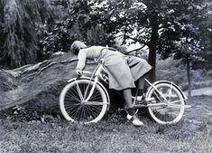 Martin Munkácsi, Woman on boulder with bicycle, 1936