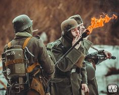 Joey lighting cigarette off the end of an MDF flame trooper's flame thrower