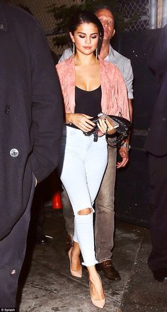 Poker face: Selena Gomez avoided direct eye contact with photographers upon leaving the Abbey club in West Hollywood on Saturday night