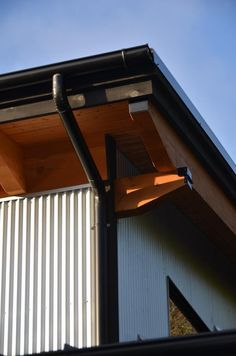 Halfround black gutter corner looking fabulous Timber frame and