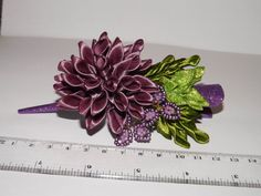 Hey, I found this really awesome Etsy listing at https://www.etsy.com/listing/219856181/purple-kanzashi-fabric-flower-hair-clip