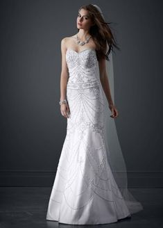 The fashion enthusiast's reverie! This striking wedding dress is the pinnacle of sophistication and style. All over beading makes this stunning wedding dress a special and unique piece of art. Sweetheart neckline accentuates your bust and opens up your face. Sweep train. Sizes 0-14. Soft White available online, and in limited store. Back Zip. Dry Clean Only. The David's Bridal Luxe Collection features bridal gowns designed with exquisite embellishments and luxurious ...