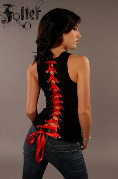 I'm such a sucker for corset tops, even if it's just a little ribbon. Possible DIY project? One basic black beater, preferably quite thick. Two strips of some thicker cloth. One sewing machine. Some grommets. Enough ribbon of your choice colour. Diy Cut Shirts, T Shirt Diy, Diy Tshirt Ideas, Cut Up T Shirt, Angel Outfit, Diy Kleidung, Diy Vetement, Clothing Hacks, Refashioned Clothes