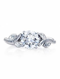 """De Beers  Inspired by Aphrodite's love for Adonis, """"Adonis Rose"""" ring: a brilliant round diamond flanked by rose stems."""