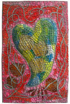 Romance Languages by Juanita Canzoneri.  Base collage incorporates Italian and Spanish magazine pages, along with flower petals and colored paper. The background is worked in tempered glass and the heart in plate glass.