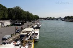 Along the River Seine you can see a variety of boats moored up, such as in this photo where you can find house boats as well tour boats going all along the river's edge.  You may also like www.eutouring.com