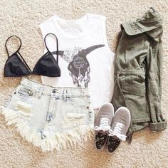 army jacket, graphic top, faded denim shorts