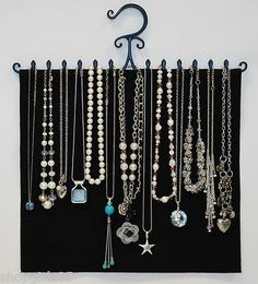 NEW! WOW JEWELRY HANGER FOR NECKLACES!!  TIME TO GET ORGANIZED? LOOK NO FURTHER THAN THIS GREAT PRODUCT.  EASY TO USE. TANGLE FREE NECKLACES. GREAT FOR LONG NECKLACES!! USE BOTH SIDES FOR DOUBLE STORAGE. SPACE SAVING DESIGN!!  HANGS ON ROD OR HOOK IN YOUR CLOSET, BEDROOM OR BATHROOM EVERY THING IS NEAT AND YOU CAN PICK OUT YOUR NECKLACE FAST AND EASY!!