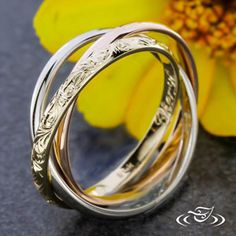 Design Your Own Unique Custom Jewelry at Green Lake Jewelry Works! 14kt tri color gold rolling ring band with hand engraved yellow gold band