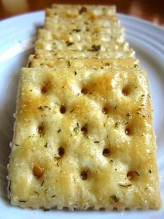My mom makes these at the holidays and they are INCREDIBLE!  Fire Crackers ~ 1 lb unsalted Saltine Crackers, cup Canola Oil, Ranch Dressing Mix, Red Pepper Flakes, Garlic Powder. Once you start munching you just can't stop!!