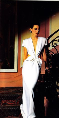 Tina Chow in Yves Saint Laurent 80s vintage couture fashion white gown dress long cut out back sides short sleeves padded shoulders retro 40s style:
