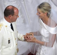 Prince Albert II and Princess Charlene exchanged rings during the ceremony, with the groom being the first to put a ring on his bride's finger, 2 July 2011