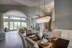 The shape is great Clarissa Glass Drop Rectangular Chandelier over the dining table from Pottery Barn